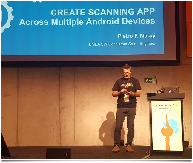 On stage at the barcamp presenting: Barcode scanning on Android